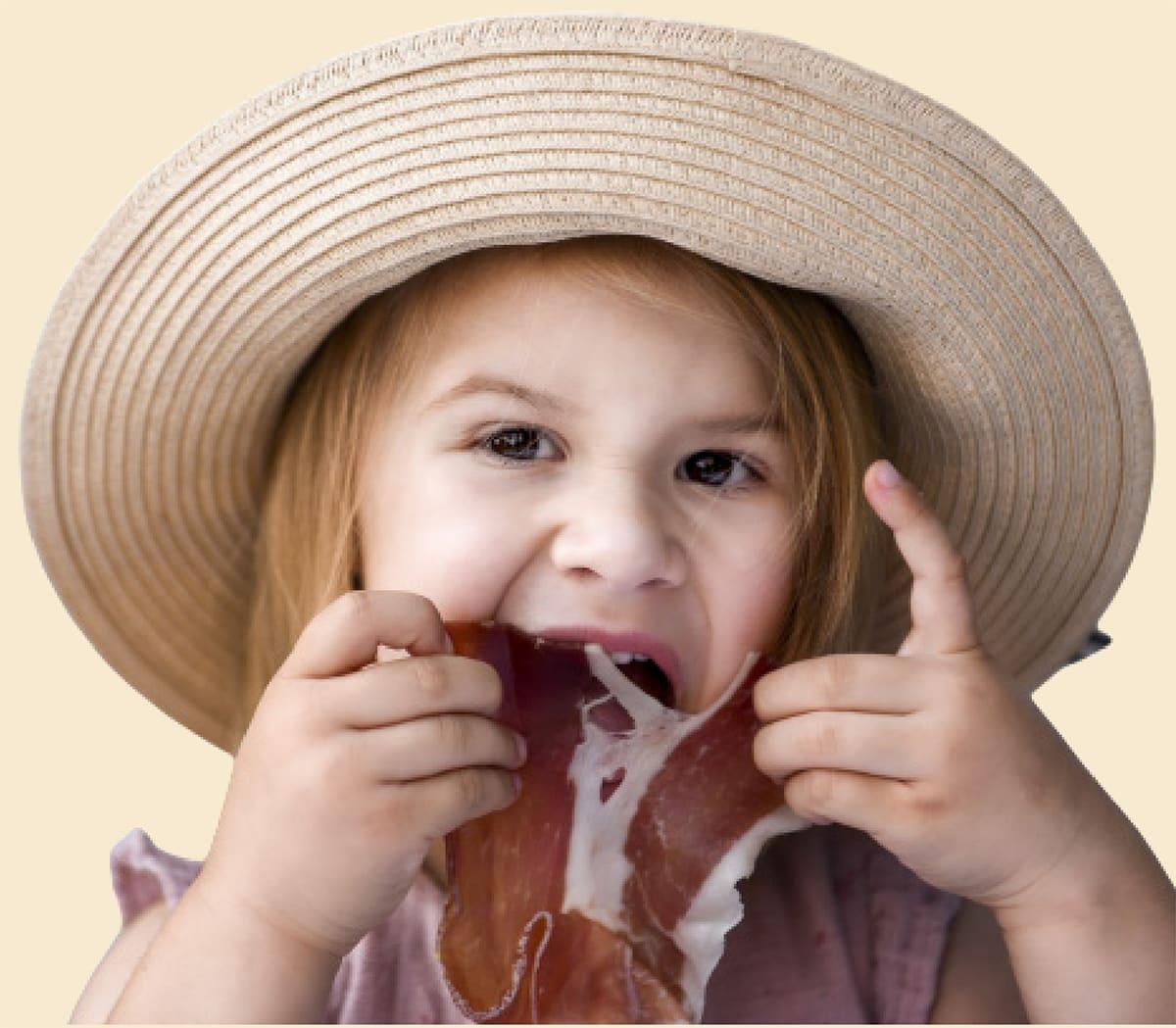 Devojčica jede Njeguški pršut